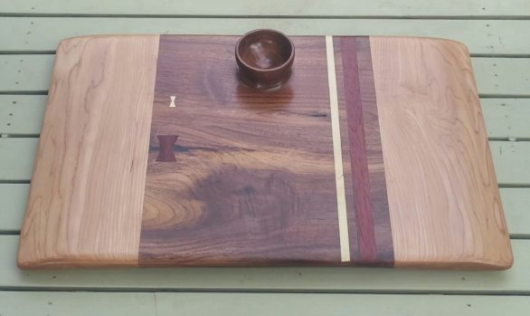 Black walnut and hard maple serving board with African bloodwood and holly accents